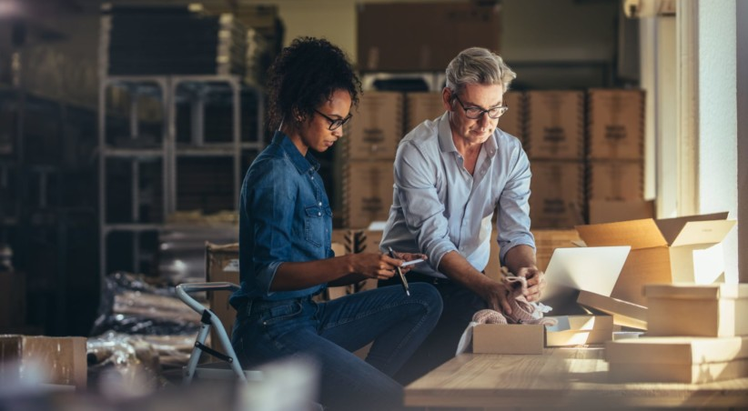 Small business owners managing cash flow gaps