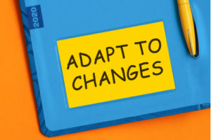 A Notebook that says adapt to changes
