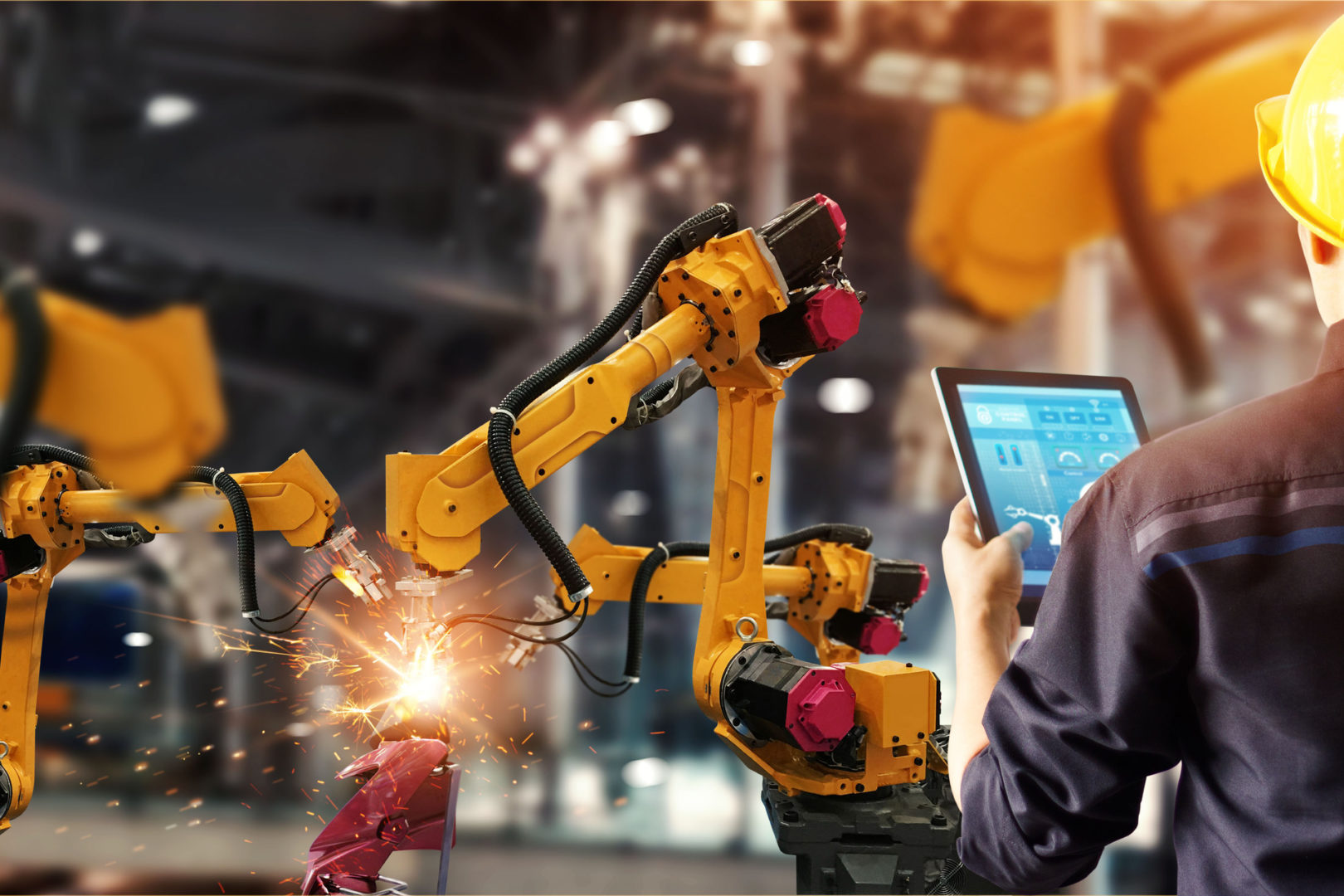 Engineer check and control welding robotics automatic arms machine in intelligent factory
