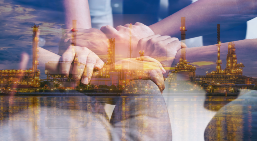 Double exposure of hands collaboration of teamwork and oil refinery at sunset for business Energy Concept